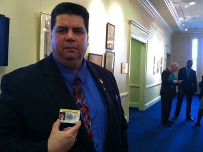 """Del. Michael Smigiel shows off his permit to carry a gun. To obtain it, he had to prove he had a """"good and substantial reason"""" to be armed."""