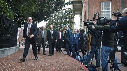 Maryland Gov. Larry Hogan, left, arrived for a news conference in front of the Government House to sum up his thoughts about this year's General Assembly actions on sine die.