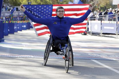 Daniel Romanchuk of Mount Airy poses for photos as the winner of the pro wheelchair men's division of the New York City Marathon in New York's Central Park on Sunday, Nov. 3, 2019.