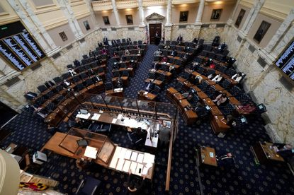 Members of the Maryland House of Representatives are seen socially distanced to prevent the spread of COVID-19 during the first day of the state's 2021 legislative session, Wednesday, Jan. 13, 2021, in Annapolis, Md. (AP Photo/Julio Cortez)