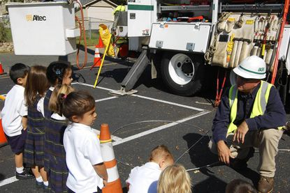 Baltimore Gas & Electric employee Craig Hart speaks to the St. Joan of Arc School's pre-kindergarten students about the dangers of downed wires during a storm.