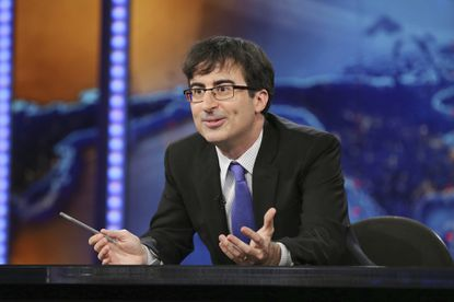 """John Oliver as summer guest host of """"The Daily Show with Jon Stewart"""" on June 10, 2013 in New York City."""