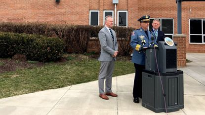 Chief of Police Gary Gardner, center, stands with Superintendent Michael Martirano, left, and County Executive Allan Kittleman outside Mt. Hebron High School on March 27 to announce new school security measures.