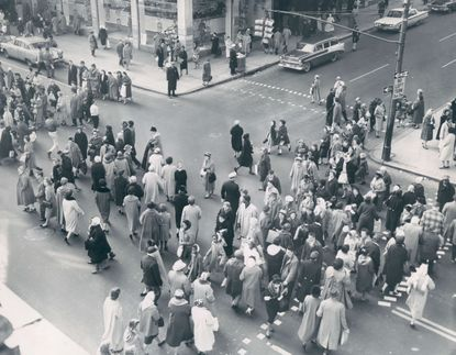 Baltimoreans flock to stores at the intersection of Howard and Lexington streets in February 1960.