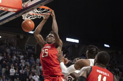 Maryland forward Jalen Smith (25) dunks against Penn State during the second half in State College, Pa., on Tuesday, Dec. 10, 2019.