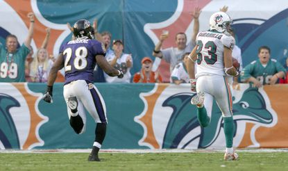 Miami wide receiver Greg Camarillo outruns Ravens safety Jamaine Winborne for the game-winning touchdown in overtime as the Dolphins earned their first win of the 2007 season.
