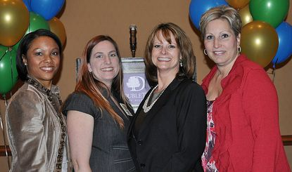 Jennifer Terrell, Kirsten Beck, Colleen Brady and Rachel Heird pose at ROMG Charter Night. Terrell, Beck and Heird co-chaired the event, and Brady is the new Chamber president.