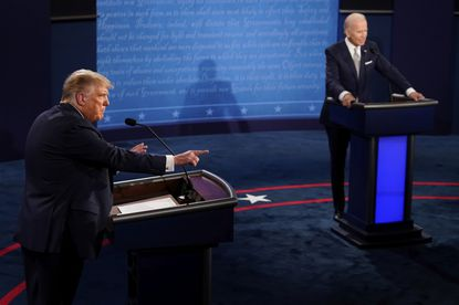 President Donald Trump makes a points as Democratic presidential candidate former Vice President Joe Biden listens during the first presidential debate Tuesday, Sept. 29, at Case Western University and Cleveland Clinic, in Cleveland, Ohio.