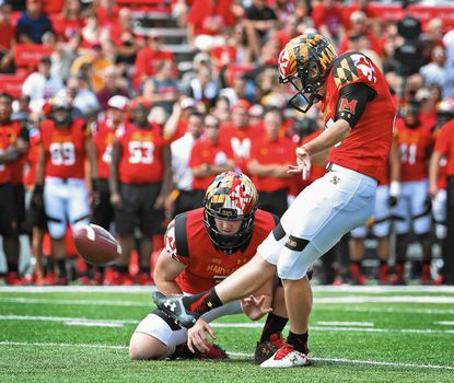 Maryland kicker Brad Craddock, right, kicks a field goal with Caleb Rowe holding in the first quarter. Maryland defeated Richmond 50-21 at Byrd Stadium.