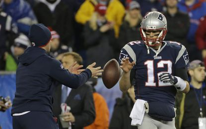 In this Jan. 18, 2015, file photo, New England Patriots quarterback Tom Brady has a ball tossed to him during warmups before the NFL football AFC Championship game against the Indianapolis Colts in Foxborough, Mass. Tom Brady is expected to file an appeal of his four-game suspension for his role in deflating footballs for the AFC championship game.