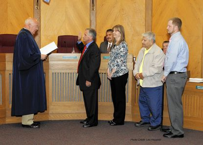 With family members watching Monday night, newly elected Steve Gamatoria is sworn in to the Havre de Grace City Council by retired Harford County Circuit Court Judge Emory Plitt.