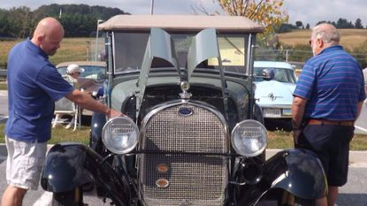 John Mangold of Manchester, left, and Gene Yingling of Westminster, right, look over a 1929 Model A Ford at the second annual classic car, truck and motorcycle show at Manchester Valley High School in 2014. This year's event is set for Sept. 23.