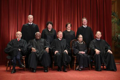 Justices of the U.S. Supreme Court pose during a formal group photograph in the East Conference Room of the Supreme Court in Washington on Nov, 30, 2018. Seated from left: Associate Justice Stephen Breyer, Associate Justice Clarence Thomas, Chief Justice John Roberts, Associate Justice Ruth Bader Ginsburg and Associate Justice Samuel Alito Jr. Standing from left: Associate Justice Neil Gorsuch, Associate Justice Sonia Sotomayor, Associate Justice Elena Kagan and Associate Justice Brett Kavanaugh. MUST CREDIT: Bloomberg photo by Andrew Harrer.
