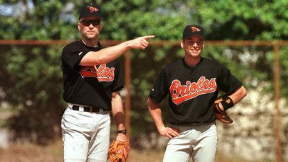 The Orioles' Cal Ripken, left, jokes in March 1997 in Fort Lauderdale, Fla., with Mike Bordick, who replaced him at shortstop. Ripken moved to third base.