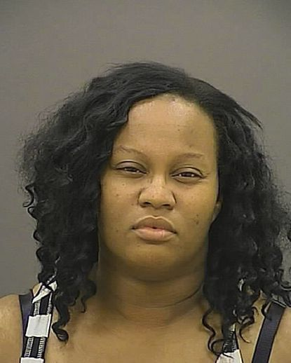 Woman charged with running down three is held without bail