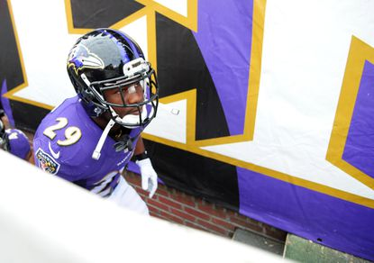 Ravens running back Justin Forsett runs onto the field at M&T Bank Stadium before the Nov. 30 game against the Chargers.