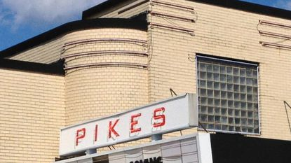 Exterior of The Pikes theater, which has reopened as a movie theater.
