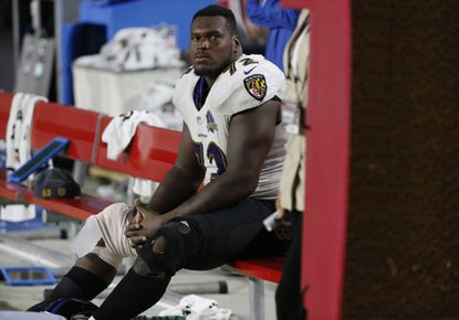 Ravens guard Kelechi Osemele (72) sits on the bench after injuring his knee against the Arizona Cardinals during the second half, Monday, Oct. 26, 2015, in Glendale, Ariz.