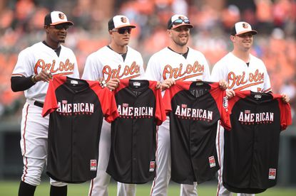 Orioles players (l-r) Adam Jones, Manny Machado, Darren O'Day and Zach Britton are honored for their American League All-Star selections before a baseball game against the Washington Nationals at Camden Yards on July 12, 2015 in Baltimore.