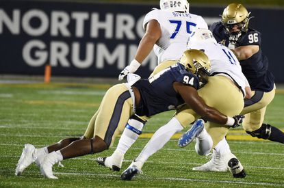 Rising senior J'arius Warren, shown making a tackle against Tulsa quarterback Zach Smith on Dec. 5, 2020, made four starts at defensive tackle before losing the job to Tobe Okafor. Warren has the experience to plug a hole on the defensive line.