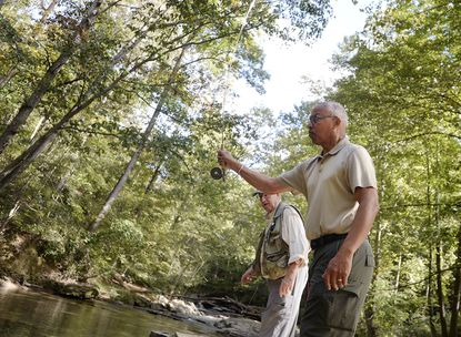 Lt. Governor Boyd Rutherford casts a fly rod as John Neely, chair of the Maryland Sport Fisheries Advisory Commission, looks on at Morgan Run Natural Envionment Area near Gamber during a visit Monday morning, Oct. 4, 2021.
