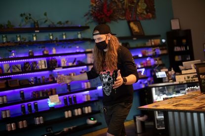 Manager Jeff Trout talks about the campaign to end the sale of flavored tobacco products in Chicago at Cloud Vapor Lounge in Logan Square, Thursday, Sept. 10, 2020, in Chicago. (Erin Hooley/Chicago Tribune)