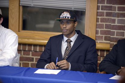 Gilman's Kai Locksley signs to play at Texas in February 2015.