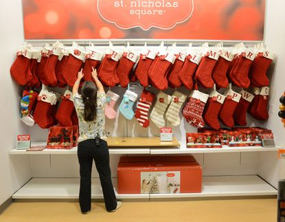 """Megan Shoemaker of Fairless Hills, Pa., works on a Christmas stocking display at Kohl's in Yardley, Pa., on Friday, Oct. 2, 2015. Kohl's plans to add 69,000 seasonal jobs, with hiring to start this month, """"to ensure an easy shopping experience and great service during the busy holiday shopping season."""""""
