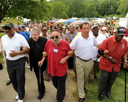 Civil rights activists from the '60s and others sing freedom songs as they take part in the Unity Walk to the Historical Marker at Gwynn Oak Amusement Park to commemorate the 50th anniversary of the desegregation of the park. From left: Tony Fugett, President of Baltimore County Chapter of the NAACP; Bishop Denis J. Madden, Archdiocese of Baltimore; Rabbi Arthur Waskow; Baltimore County Executive Kevin Kamenetz; and Cyril O. Byron, Sr. Ed.D, a Tuskegee Airman.