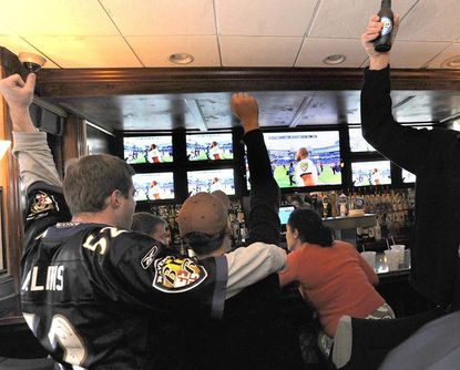 Fans cheer the Ravens' win over the New England Patriots at Looney's Pub in Canton in 2010.