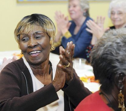 Irma Peay, 74, claps to the music provided by the Parkville Baladiers from American Legion Post 183 at the 31st annual Greater Towson Jaycees Senior Citizens Thanksgiving Dinner at Towson Presbyterian Church.