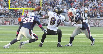 "Ravens wide receiver Mark Clayton drops a crucial fourth-down pass with seconds left in the game as Patriot defenders Darius Butler, left, and Brandon McGowan close in. The drop at New England's 8-yard line ended the Ravens' last-minute comeback bid. ""It was a perfect ball. I dropped it,"" Clayton said afterward. ""I just wasn't able to come up with it, and it cost us the game."""