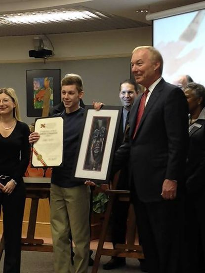 Westminster High School Senior Chris Scott stands with Comptroller Peter Franchot Tuesday after he received the Maryland Masters Art Award.