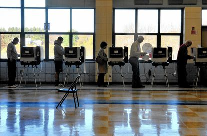 More than 422,000 voters met the deadline for registering for the Feb. 4 primary election for the late U.S. Rep. Elijah Cummings' longtime seat, according to new figures that reflect the dominance of Baltimore Democrats in the district. In this 2012 photo, people vote at Dayton Oaks Elementary School in Howard County.