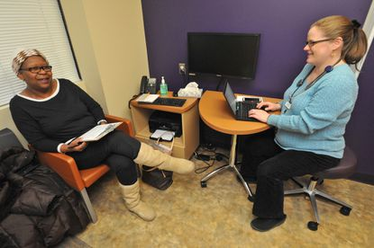 White Marsh, MD - 1/12/15 - Patient Jean Donnell, 63, of Pikesville, left, chats with the family practitioner, Dr. Joy Baldwin, at Evergreen Health Care at White Marsh. She is very happy with the holistic approach at the Evergreen Health Center. The four Evergreen Health Care centers are part of the Evergreen Health Cooperative, one of 23 co-op insurers nationwide created under the Affordable Care Act.