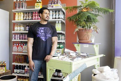 Phil Price works at the Main Street health food store owned by his mother, Monika Price, who has applied for reinbursements from the city's incentive program intended to attract more businesses to Main Street.
