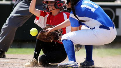 Bohemia Manor's Aubrey Heath scores past Sparrows Point's Karen Fritzges (11) during the Class 1A softball state championship between Saturday.