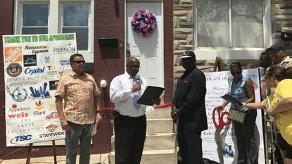 Church restores abandoned East Baltimore home to give to veteran