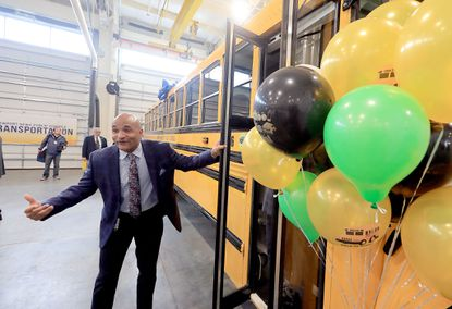 The director of transportation for Newport News, Virginia public schools, Shay Coates, invites people onto the school system's newest propane powered bus Tuesday October 22, 2019. (Rob Ostermaier/The Daily Press).