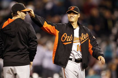 Orioles pitcher Wei-Yin Chen reacts after a 4-0 victory over the Seattle Mariners at Safeco Field.