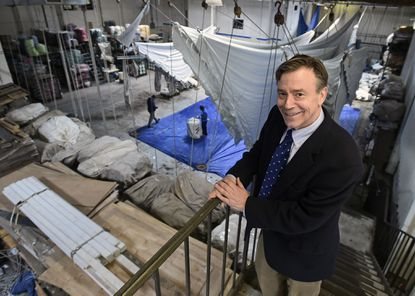 Towson, MD. -- Bryan Loane, the sixth- generation family owner of Loane Bros. Inc. in Towson, is pictured in the company's warehouse where large party tents are washed and dried after rentals. The company is celebrating its 200th year in business.