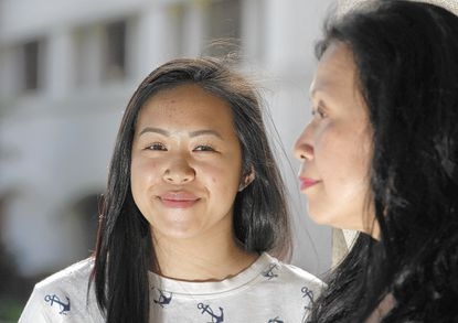 Vivian Chan, right, whose daughter Vanessa attends San Marino High School, joined Wechat about seven months ago. When news of SCA 5 broke, the phone-based group-messaging platform became a tool for fomenting action against the amendment.