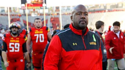 Maryland interim head coach Mike Locksley walks off the field after a game against Indiana on Nov. 21, 2015, in College Park. Locksley is an accomplished assistant and well-regarded recruiter, but his record as a head coach is 3-31.