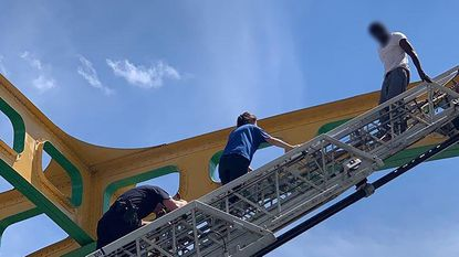 The Baltimore City Fire Department provided a ladder truck, which members of the Baltimore Police Crisis Response Team climbed.