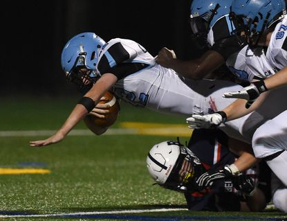 C. Milton Wright quarterback Carter Goscinski dives into the endzone for a touchdown during the game at Bel Air Friday, September 24, 0221.