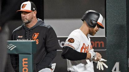 Orioles' Chris Davis, right, walks past manager Brandon Hyde after flying out pinch hitting against the A's in the ninth inning. Davis is still hitless in the season. The A's defeated the Orioles by score of 10 to 3 at Oriole Park at Camden Yards.