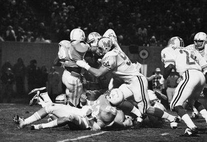 Maryland's Randy White (94) and Harry Walters (52) team up to stop Tennessee's Stanley Morgan (21), during the second quarter of the Liberty Bowl game in Memphis, Dec. 17, 1974.