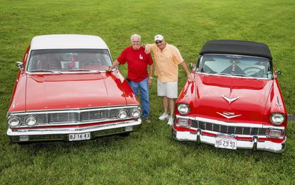 Dan Sivley, of Beltsville, with his 1964 Ford Galaxie 500 XL; and Mike Templeton, of College Park, with his 1956 Chevrolet Bel Air brought their cars to Granville Gude Park, where they are chairing a car show July 5.