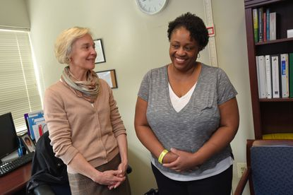 Cheryl Denby (right), who lost 30 pounds so far after Bariatric Embolization of Arteries for the Treatment of Obesity at Johns Hopkins. She talks with Linda Bunyard, a registered dietitian at The Johns Hopkins Weight Management Center.