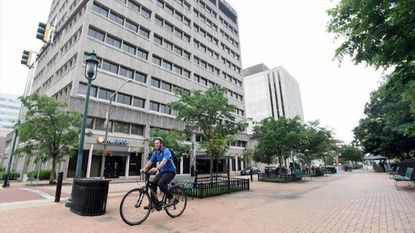 Chris Cucuzzella, a Loyola Blakefield physics teacher who lives in Towson, takes off from a Bike to Work Day pit stop in Towson over the summer. Towson, Catonsville, Dundalk and other areas around the county all have bike paths or dedicated bike lanes.
